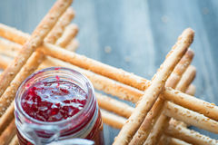 Bunch of homemade grissini breadsticks in a glass jar on wooden surface Royalty Free Stock Photography