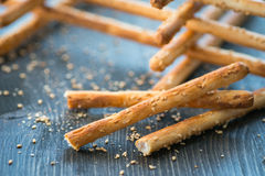 Bunch of homemade grissini breadsticks in a glass jar on wooden surface Royalty Free Stock Image