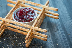 Bunch of homemade grissini breadsticks in a glass jar on wooden surface Royalty Free Stock Photo