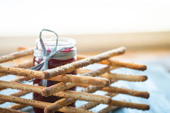 Bunch of homemade grissini breadsticks in a glass jar on wooden surface Stock Images