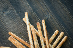 Bunch of homemade grissini breadsticks on wooden surface Royalty Free Stock Photo