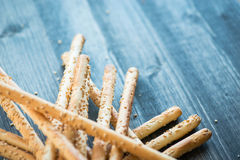 Bunch of homemade grissini breadsticks on wooden surface Royalty Free Stock Image