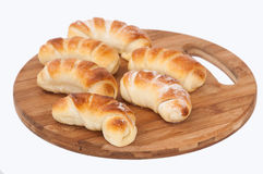 A bunch of homemade rolls on a kitchen wooden board Royalty Free Stock Photo