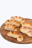 A bunch of homemade rolls on a kitchen wooden board Royalty Free Stock Image