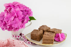 Bunch of hortensia pink flowers and a cake Stock Image