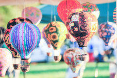 Bunch of hot air balloon toys dangling in  the wind Royalty Free Stock Photography