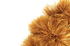Bunch of hristmas golden tinsel. Royalty Free Stock Photo