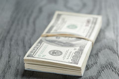 Bunch of hundred dollar notes tied with rubberband Royalty Free Stock Images