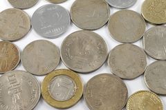 A bunch of Indian Currency Coins. Old and new shot on white background Stock Images