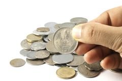 A bunch of Indian Currency Coins in Hand Stock Photo