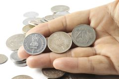 A bunch of Indian Currency Coins in Hand Stock Image