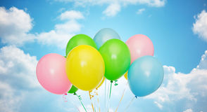 Bunch of inflated helium balloons over blue sky Royalty Free Stock Images