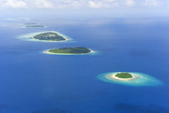 Bunch of islands in Raa Atoll Royalty Free Stock Photography