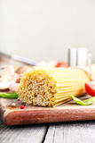 Bunch of Italian spaghetti on wooden table closeup Stock Photography