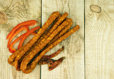 Bunch of kabanos smoked sousage on wooden background Royalty Free Stock Photo