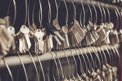 Bunch of key hanging on the wire in key maker shop Stock Images