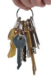 Bunch of keys. The hand holds a sheaf of metal keys stock image