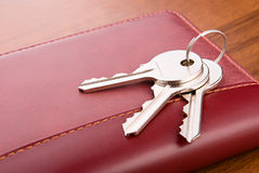 Bunch of keys. Keys close-up on brown leather purse Royalty Free Stock Photo