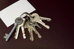 Bunch of keys and a business card. Royalty Free Stock Photo