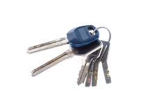 Bunch of keys from a door on a white background close up Stock Photo
