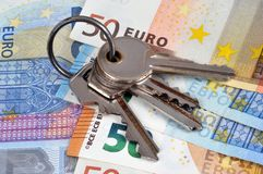 Bunch of keys on euro banknotes royalty free stock photo