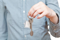 Bunch of keys with fob in hand close up. On white background Royalty Free Stock Image