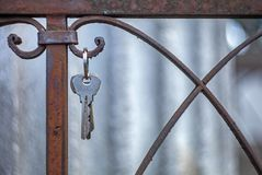 A bunch of keys hanging on the rusted fence of the grave in the royalty free stock photography