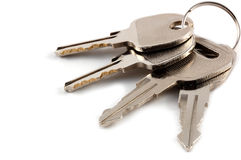 A bunch of keys isolated. Against a clean white background Royalty Free Stock Image