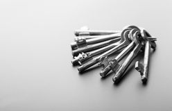 Bunch of keys isolated on grey Royalty Free Stock Photography