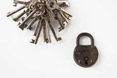 Bunch of keys and old padlock on white background Stock Image
