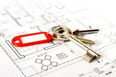 Bunch of keys with red keychains at building drawing Royalty Free Stock Images