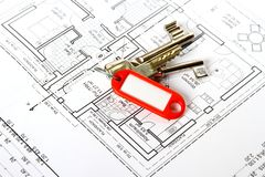 Bunch of keys with red keychains at building drawing Royalty Free Stock Image
