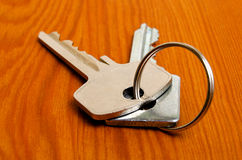 Bunch of keys on the table. Royalty Free Stock Photo