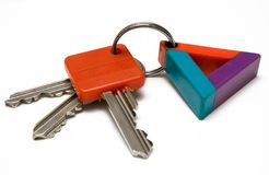Bunch of Keys w/ Colorful Tag. Three keys with tag against white background Royalty Free Stock Image