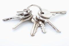 Bunch of keys on white background Stock Image
