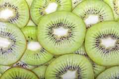 A bunch of kiwis cut. Into slices stock image