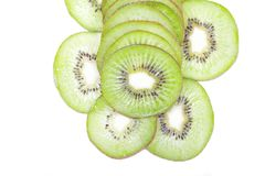 A bunch of kiwis cut into slices isolated stock images