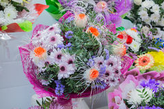 Bunch of large unusual white chrysanthemums and orange roses Royalty Free Stock Photography