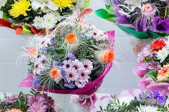 Bunch of large unusual white chrysanthemums and orange roses Stock Photography