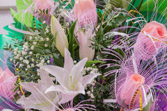 Bunch of large white lily and pink roses Stock Image