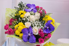 Bunch of large yellow chrysanthemums and pink white roses Stock Photo