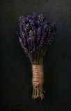 Bunch of lavender flower on dark tray. Vertical photo with single bunch of lavender flower bonded by natural cord with vintage mood. Purple blooms are dry as a Stock Images
