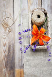 Bunch of lavender flowers and lily in basket  on an old wood tab Royalty Free Stock Photography