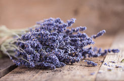 Bunch of lavender flowers on old wood table Stock Photos