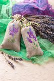 Bunch of lavender flowers and sachets filled with dried lavender. Stock Photo