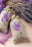 Bunch of lavender flowers and sachets filled with dried lavender. Stock Images