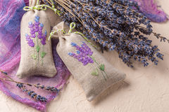 Bunch of lavender flowers and sachets filled with dried lavender. Royalty Free Stock Images