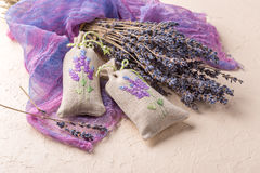 Bunch of lavender flowers and sachets filled with dried lavender. Stock Photography