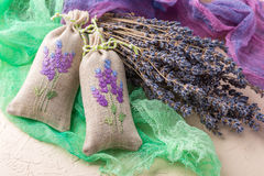 Bunch of lavender flowers and sachets filled with dried lavender. Stock Photos