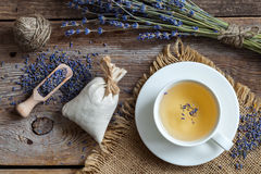 Bunch of lavender flowers, sachets and lavender tea cup. Royalty Free Stock Photography